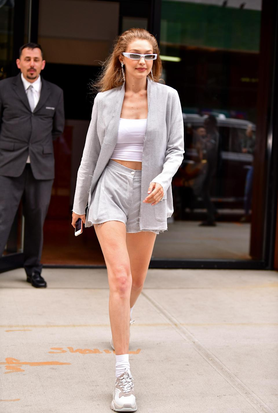 <p>Forget Bella for one moment, sister Gigi has been serving up some Insta-worthy looks out and about in New York. The model rocked a two-piece suit with micro sunnies and trainers on 20 June. <em>[Photo: Getty]</em> </p>