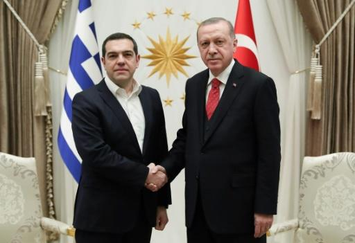 Greek Prime Minister Alexis Tsipras shakes hands with Turkish President Recep Tayyip Erdogan on his second visit in four years