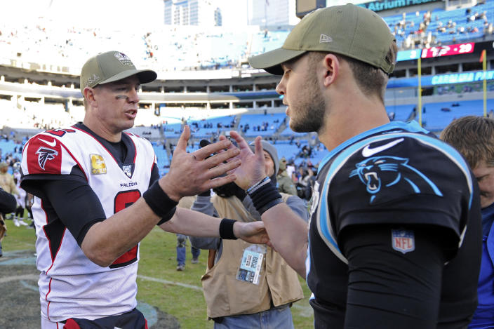 Atlanta Falcons quarterback Matt Ryan (2) and Carolina Panthers quarterback Kyle Allen, right, speak following an NFL football game in Charlotte, N.C., Sunday, Nov. 17, 2019. The Falcons won 29-3. (AP Photo/Mike McCarn)