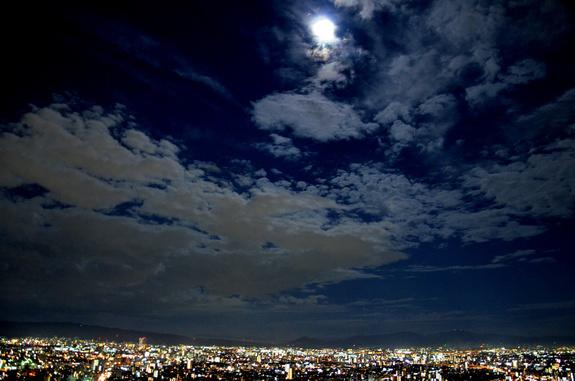 Night sky watcher Angela Saeki caught the blue moon from her balcony on the 34th floor in Osaka, Japan, August 30, 2012.