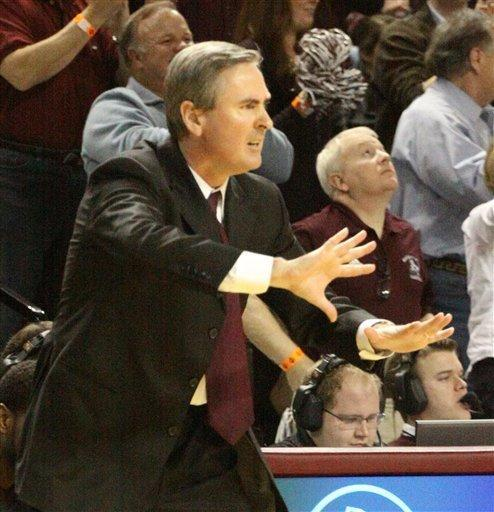 Mississippi State coach Rick Stansbury gestures to his team during the first half of their NCAA college basketball game with Mississippi in Starkville, Miss., Thursday, Feb. 9, 2012. (AP Photo Jim Lytle)