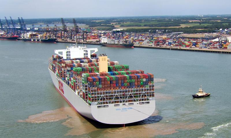 Hong Kong, the world's largest container ship, which can carry 21,413 containers, docks in Felixstowe, Suffolk, in 2017.