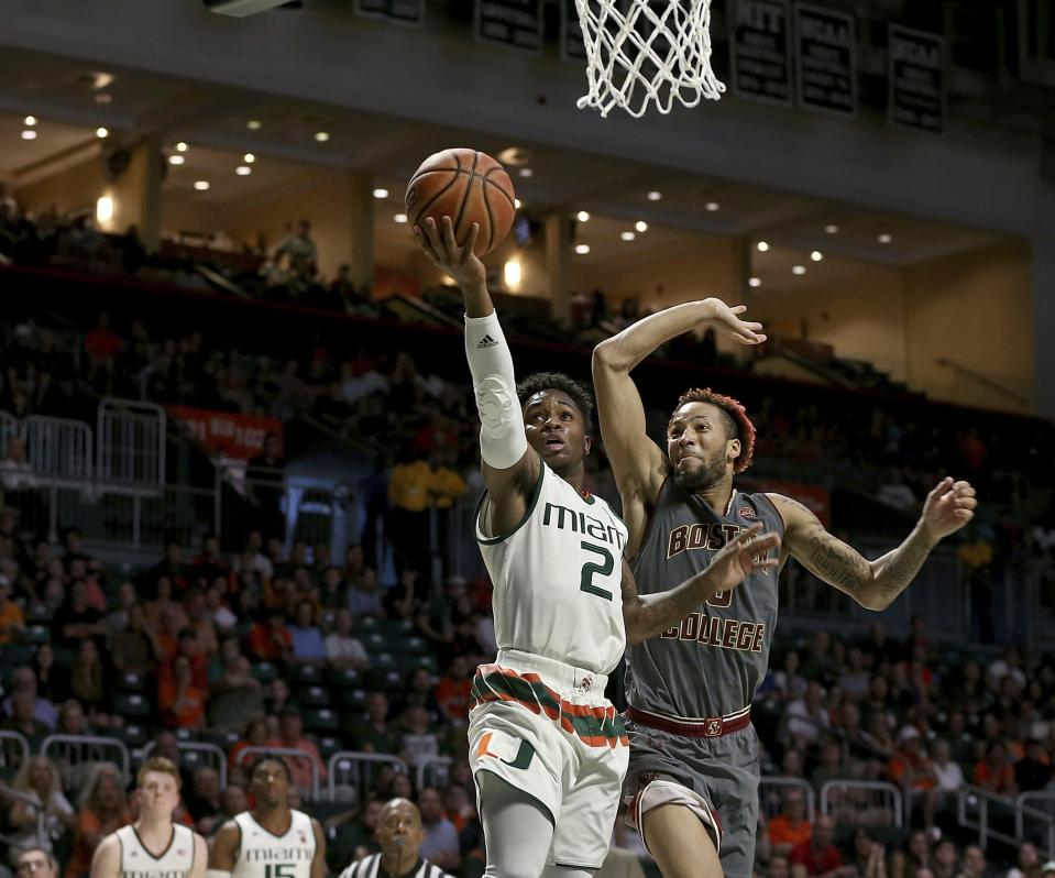 Miami guard Chris Lykes, left, goes to the basket against Boston College guard Ky Bowman, right, in the second half of an NCAA college basketball game in Coral Gables, Fla., Saturday, Feb. 24, 2018. (Pedro Portal/Miami Herald via AP)