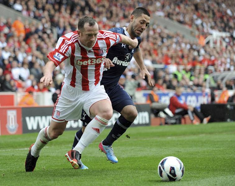 Stoke City's Charlie Adam, left, and Tottenham Hotspur's Clint Dempsey battle for the ball during the English Premier League soccer match at the Britannia Stadium, Stoke-on-Trent, England, Sunday May 12, 2013. Tottenham Hotspur won the match 1-2. (AP Photo/PA, Clint Hughes) UNITED KINGDOM OUT NO SALES NO ARCHIVE
