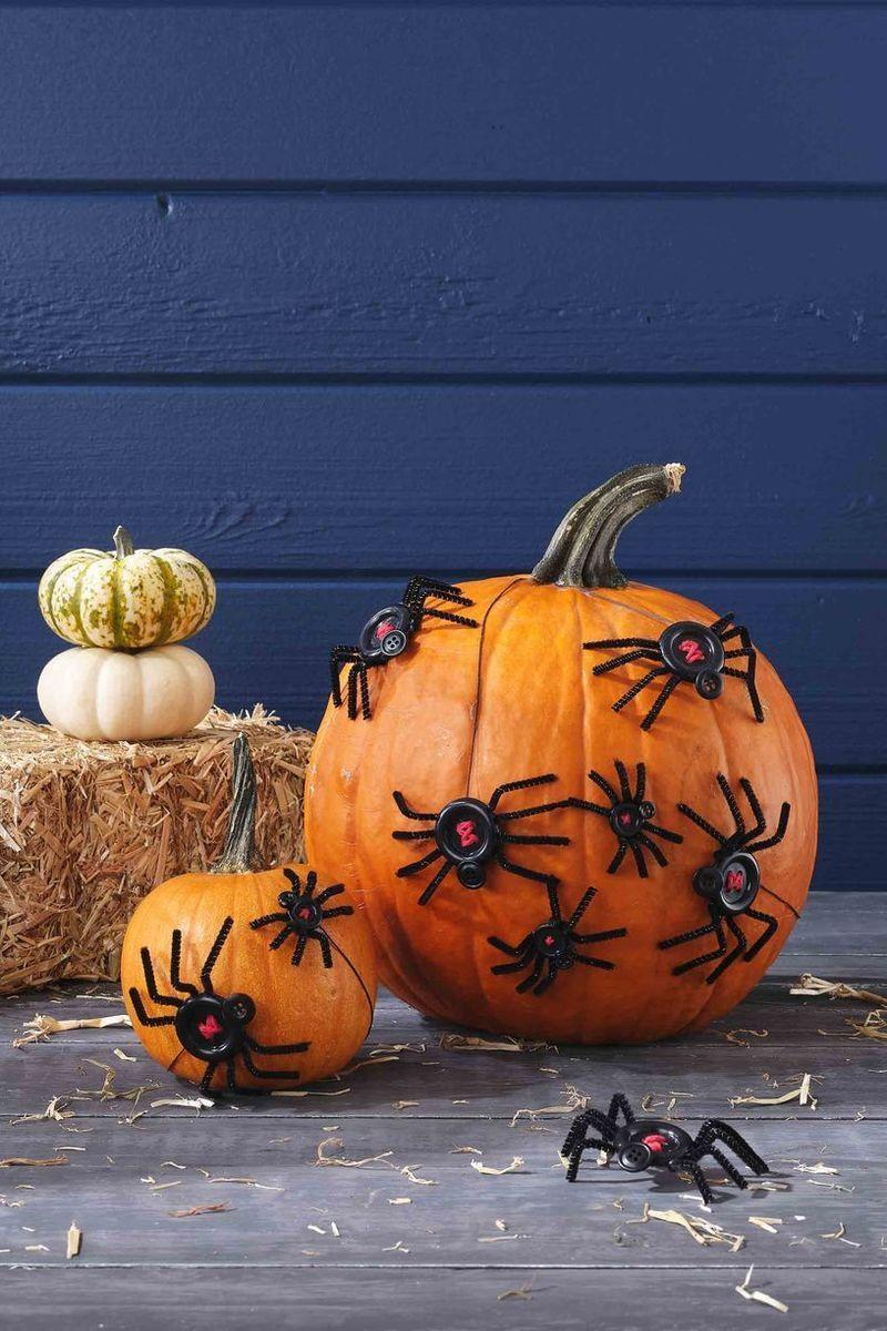 """<p>These """"spiders"""" couldn't be cuter—or easier to make. Simply sew red string into the spider backs, then glue the body (made of buttons and pipe cleaners!) onto the pumpkin. </p><p><a class=""""link rapid-noclick-resp"""" href=""""https://go.redirectingat.com?id=74968X1596630&url=https%3A%2F%2Fwww.walmart.com%2Fsearch%2F%3Fquery%3Dblack%2Bbuttons&sref=https%3A%2F%2Fwww.thepioneerwoman.com%2Fholidays-celebrations%2Fg32894423%2Foutdoor-halloween-decorations%2F"""" rel=""""nofollow noopener"""" target=""""_blank"""" data-ylk=""""slk:SHOP BLACK BUTTONS"""">SHOP BLACK BUTTONS</a></p>"""