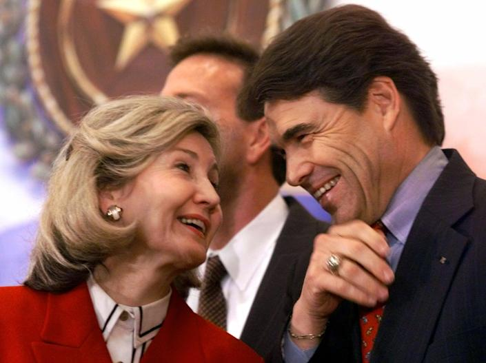 FILE - In this March 13, 2000 file photo, Texas Lt. Gov. Rick Perry, right, shares a laugh with Sen. Kay Bailey Hutchison, R-Texas, during a news conference in Austin, Texas. Perry announced Monday, July 8, 2013, that he would not seek re-election as Texas governor next year. (AP Photo/Harry Cabluck, File)