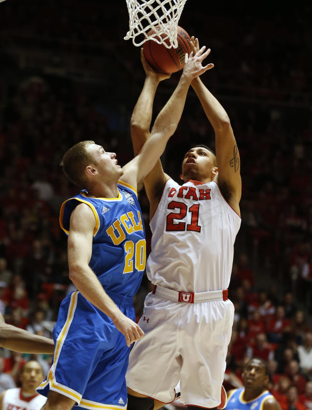 UCLA's Bryce Alford, left, tries to block the shot of Utah's Jordan Loveridge during the first half of an NCAA college basketball game in Salt Lake City, Saturday, Jan. 18, 2014. (AP Photo/George Frey)