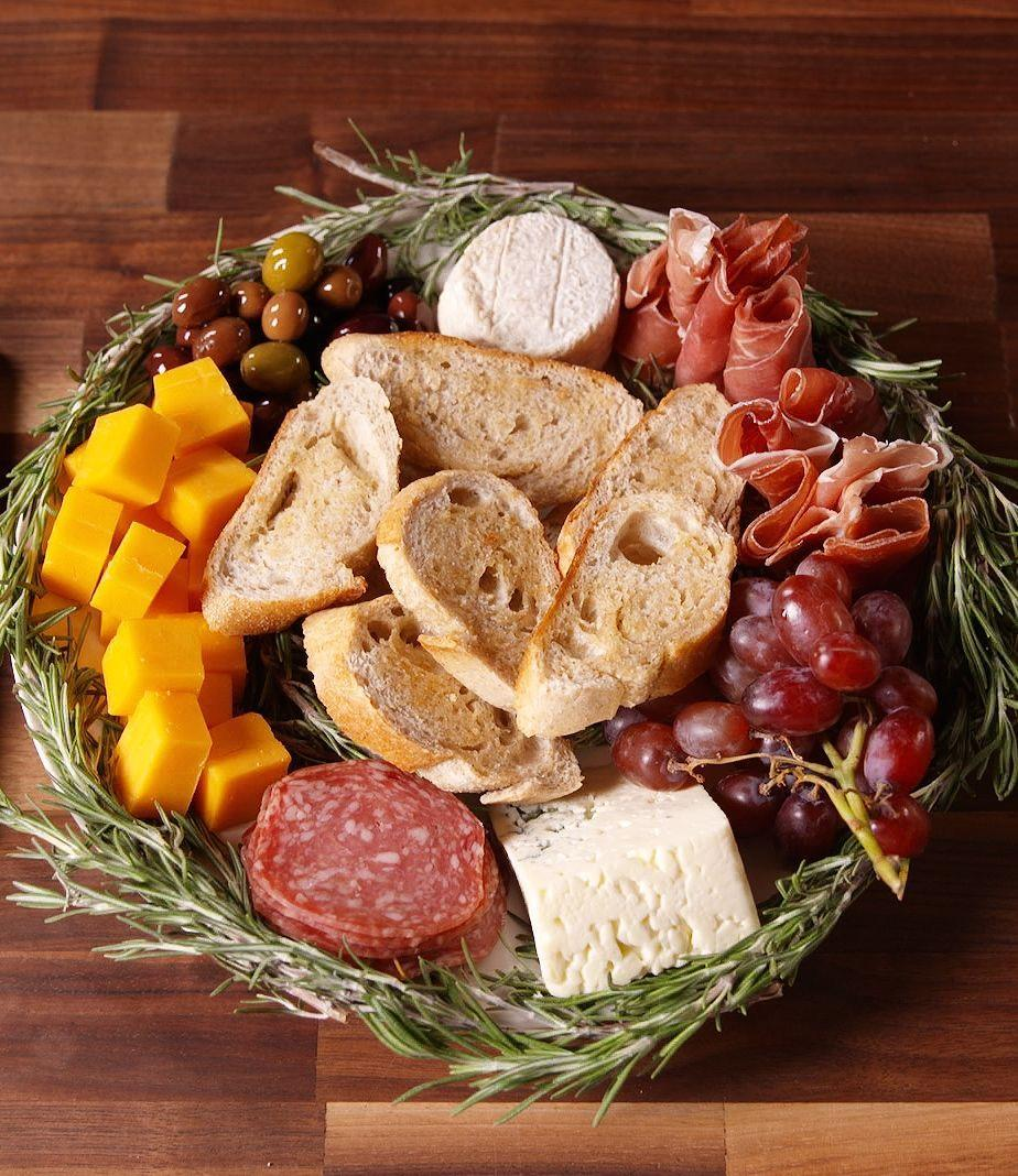"""<p>This is the only way to serve a cheese plate during the holidays.</p><p>Get the recipe from <a href=""""https://www.delish.com/cooking/recipe-ideas/recipes/a50363/antipasto-wreath-recipe/"""" rel=""""nofollow noopener"""" target=""""_blank"""" data-ylk=""""slk:Delish"""" class=""""link rapid-noclick-resp"""">Delish</a>.</p>"""