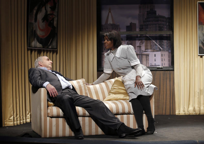 """FILE - In this Nov.15, 2012 file photo, French actor Eric Debrosse acting as former International Monetary Fund leader Dominique Strauss-Kahn, left, and actress Jelle Saminnadin acting as Nafissatou Diallo, the hotel housekeeper, who accused Dominique Strauss-Kahn of sexually assaulting her, pose during a photo opportunity as they perform in a play """"Suite 2806"""" in a Paris theatre. One-time French presidential hopeful Dominique Strauss Kahn has been to hell and back since he was charged, then acquitted in New York of making a hotel maid perform a sexual act in 2011. Now DSK will be treading the boards, in a salacious new play that recounts knock for knock what might have happened in the now infamous suite of the Manhattan Sofitel hotel. (AP Photo/Christophe Ena, File)"""