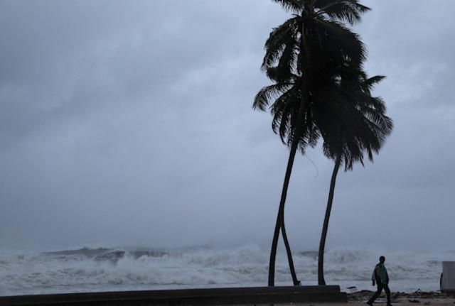 <p>A man walks on the shore as Hurricane Irma moves off from the northern coast of the Dominican Republic, in Nagua, Dominican Republic, Sept. 7, 2017. (Photo: Ricardo Rojas/Reuters) </p>