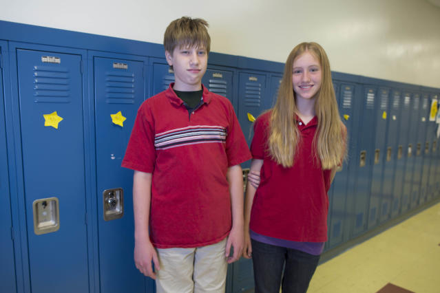 In this Thursday, June 6, 2013 photo, Tommy Figura, left, and his twin sister, Katherine, one of the twenty-four sets of twins from Highcrest Middle School in Wilmette, Ill., pose for a portrait at the school. The group is attempting to break a Guinness World record for the amount of twins in one grade which is currently 16 sets. (AP Photo/Scott Eisen)