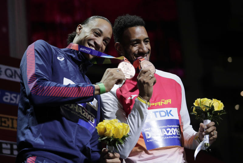 Joint bronze medalists Orlando Ortega, of Spain, right, and Pascal Martinot-Lagarde, of France, smile during the award ceremony for the men's 110 meter hurdles at the World Athletics Championships in Doha, Qatar, Thursday, Oct. 3, 2019. (AP Photo/Nariman El-Mofty)