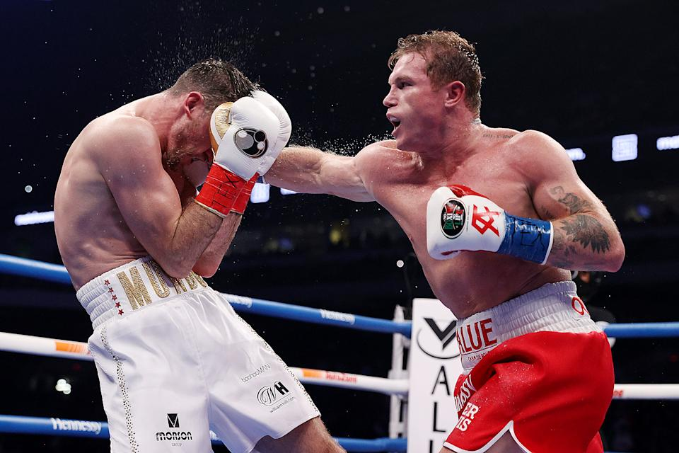 SAN ANTONIO, TEXAS - DECEMBER 19: In this handout image provided by Matchroom, Canelo Alvarez punches Callum Smith during their super middleweight title bout at the Alamodome on December 19, 2020 in San Antonio, Texas. (Photo by Ed Mulholland/Matchroom via Getty Images)