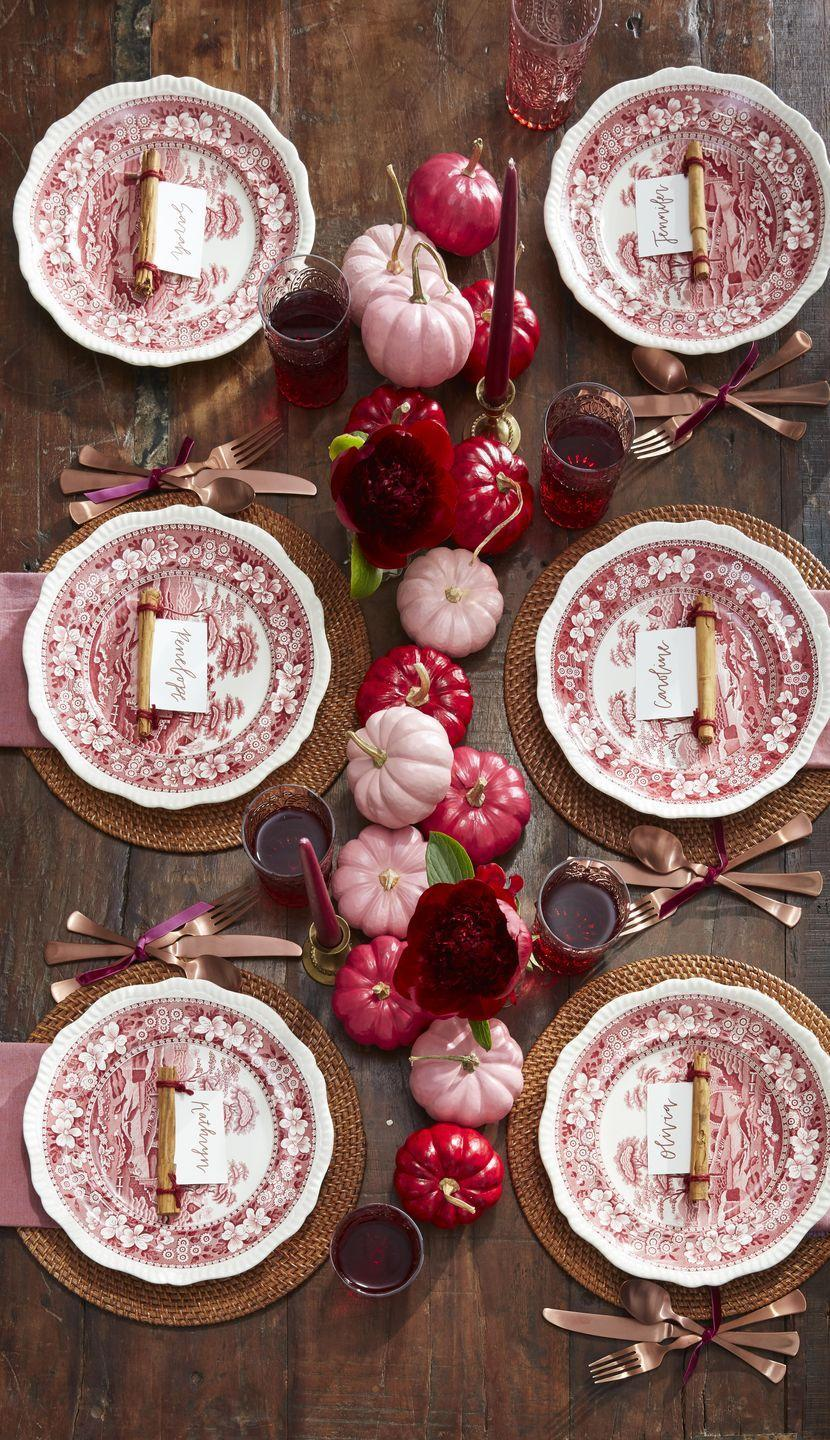 """<p>Paint small white pumpkins in differing shades of red and pink to create a lovely ombre effect down the center of the table. Add single maroon flowers in bud vases here and there for a light floral touch. Bonus: Wrap the ends of cinnamon sticks in red twine and slip place cards in the stick's natural crevice to create place cards.</p><p><a class=""""link rapid-noclick-resp"""" href=""""https://www.amazon.com/Apple-Barrel-Acrylic-PROMOABI-Assorted/dp/B00ATJSD8I/ref=sr_1_21?tag=syn-yahoo-20&ascsubtag=%5Bartid%7C10050.g.2130%5Bsrc%7Cyahoo-us"""" rel=""""nofollow noopener"""" target=""""_blank"""" data-ylk=""""slk:SHOP PAINT"""">SHOP PAINT</a></p>"""