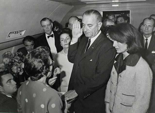 <p>Vice President Lyndon Baines Johnson (C) takes the presidential oath of office from Judge Sarah T. Hughes (2nd from L) as President John F. Kennedy's widow first lady Jacqueline Bouvier Kennedy (2nd from R) stands at his side aboard Air Force One at Love Field in Dallas, Texas, just two hours after Kennedy on Nov. 22, 1963. Attending the swearing in are Assistant Presidential Press Secretary Malcolm Kilduff (L-front), Special Assistant to the President Jack Valenti (L-Rear), Congressman Albert Thomas (2nd from L-Rear) and Congressman Jack Brooks (Far R). (Photo: JFK Library/Cecil Stoughton/The White House/Reuters) </p>