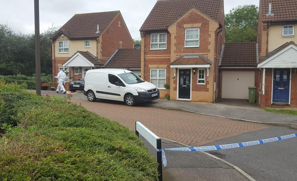 """Police at a housing estate in Emerson Valley, Milton Keynes, where two teenage boys were stabbed to death last night following a """"shocking"""" altercation. One of the two 17-year-olds, who have not yet been identified, died at the scene while the other was rushed to hospital but died in the early hours of Sunday morning."""