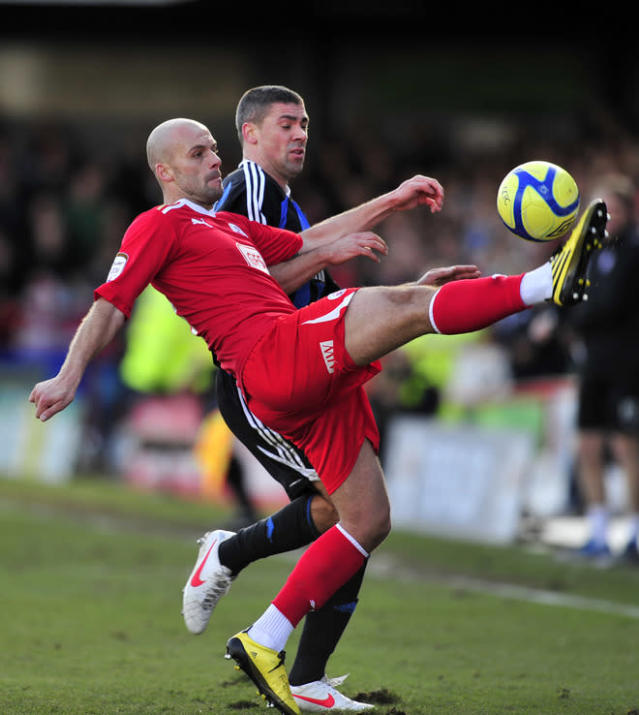"Crawley Town's English midfielder David Hunt (L) vies with Stoke City's Republic of Ireland striker Jonathan Walters (R) during their FA Cup fifth round football match against Stoke City at Broadfield Stadium in Crawley, England on February 19, 2012. RESTRICTED TO EDITORIAL USE. No use with unauthorized audio, video, data, fixture lists, club/league logos or ""live"" services. Online in-match use limited to 45 images, no video emulation. No use in betting, games or single club/league/player publications. (Photo by Glyn Kirk/AFP/Getty Images)"