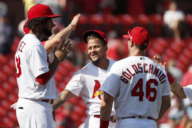 St. Louis Cardinals' Carlos Martinez, center, Jose Martinez, left, and Paul Goldschmidt (46) celebrate a 5-1 victory over the Washington Nationals in a baseball game Wednesday, Sept. 18, 2019, in St. Louis. (AP Photo/Jeff Roberson)