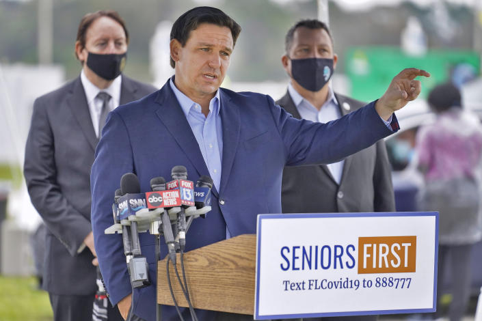 Florida Gov. Ron DeSantis gestures as he speaks to the media at a coronavirus vaccination site at Lakewood Ranch Wednesday, Feb. 17, 2021, in Bradenton, Fla. (Chris O'Meara/AP)