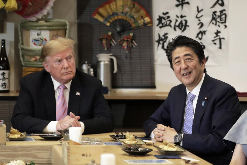 The Latest: Trump to meet Japan's emperor, talk with Abe