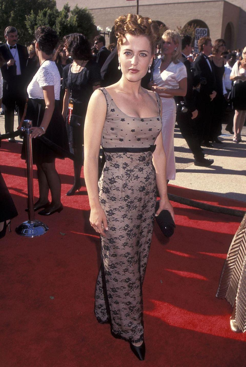 """<p>From her embellished dress to her curly updo, everything about Anderson's 1996 Emmy look screamed """"the '90s."""" </p>"""