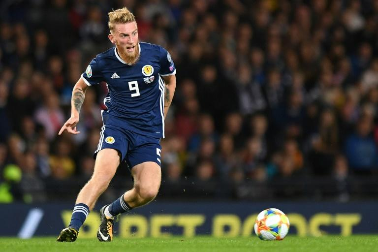 Sheffield United and Scotland striker Oli McBurnie has been charged with drink-driving
