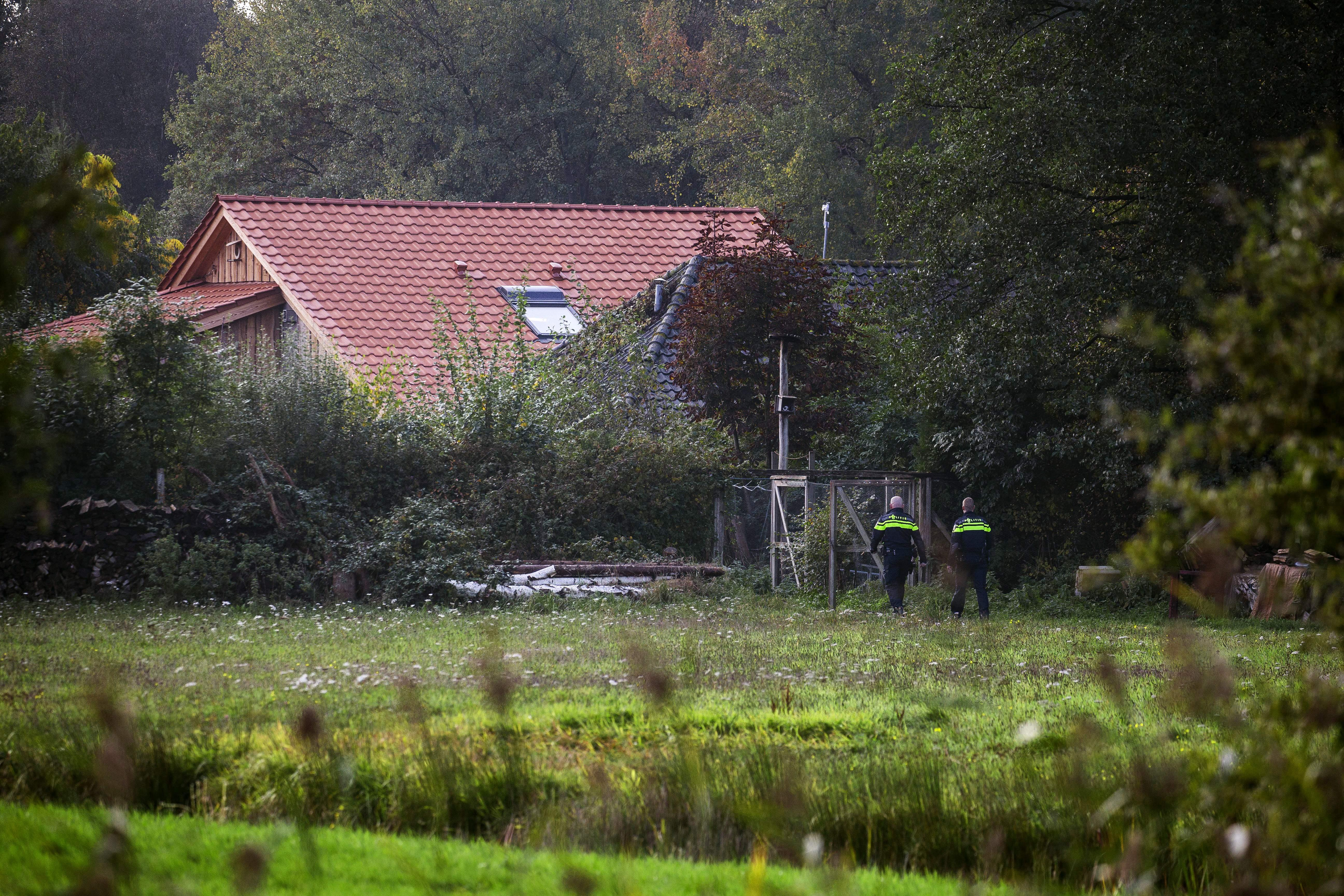 """Police inspect the area of a farmhouse in a remote area of northern Netherlands' province of Drenthe, near the village of Ruinerwold, on October 16, 2019 a day after Dutch police discovered a hidden staircase behind a cupboard leading to a cellar where a man and five others believed to be his children aged between 18 and 25 were hidden and reportedly spent years """"waiting for the end of time"""", officials said. - Local media said the family were found after one of the sons went to a nearby pub in a confused state, drank five beers and then asked for help, saying he had not been outside for nine years. Police arrested a 58-year-old man at the scene for failing to cooperate with the investigation, but he was not the father. Many questions were unanswered and police are investigating """"All scenarios"""". """"At this point we cannot give further information,"""" local police said. (Photo by Vincent Jannink / ANP / AFP) / Netherlands OUT (Photo by VINCENT JANNINK/ANP/AFP via Getty Images)"""