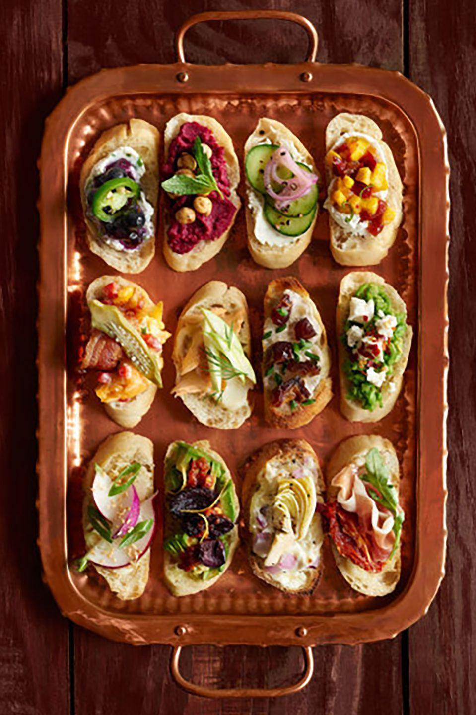 """<p>Give guests something to graze on as they dance the night away. Guests can mix and match these 12 different varieties of two-bite crostini. </p><p><strong><a href=""""https://www.countryliving.com/food-drinks/g2706/crostini-thanksgiving-recipes/"""" rel=""""nofollow noopener"""" target=""""_blank"""" data-ylk=""""slk:Get the recipe"""" class=""""link rapid-noclick-resp"""">Get the recipe</a>.</strong><br></p>"""