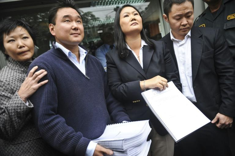 This file photo from October 10, 2012 shows Keiko Fujimori (second from R), brother Kenji (R), sister Sachi and brother Hiro presenting a petition for their father's release from prison; he remains behind bars but since-jailed Keiko is now free (AFP Photo/Ernesto BENAVIDES)