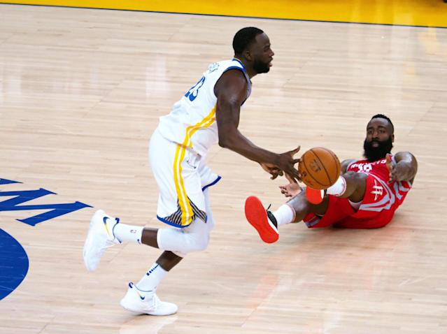 May 20, 2018; Oakland, CA, USA; Golden State Warriors forward Draymond Green (23) controls there ball as Houston Rockets guard James Harden (13) falls during the second quarter in game three of the Western conference finals of the 2018 NBA Playoffs at Oracle Arena. Mandatory Credit: Kelley L Cox-USA TODAY Sports TPX IMAGES OF THE DAY