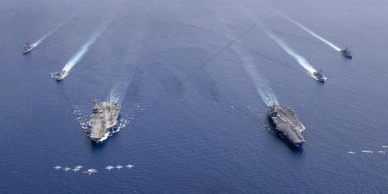 Aircraft from Carrier Air Wing 5 and Carrier Air Wing 17 fly in formation over the Nimitz Carrier Strike Force (CSF). The USS Nimitz (CVN 68) and USS Ronald Reagan (CVN 76) Carrier Strike Groups are conducting dual carrier operations in the Indo-Pacific as the Nimitz CSF.