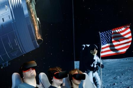 Visitors participate in an Apollo 11 virtual reality ride on the 50th anniversary of the moon landing at the Charles Simonyi Space Gallery at the Museum of Flight in Seattle