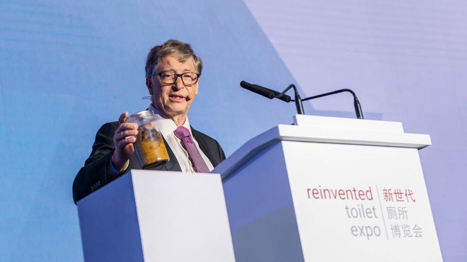 Bill Gates holding a jar of human faeces at the Beijing 2018 Reinvented Toilet Expo.