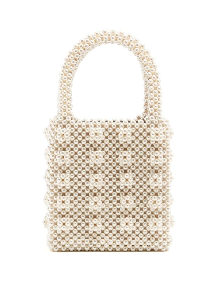 "<p>We challenge you to find a fashion blogger who doesn't own this masterpiece of a handbag. Team with a Ganni smock dress for extra style points.<br /><br /><em><a rel=""nofollow"" href=""https://www.matchesfashion.com/products/Shrimps-Antonia-faux-pearl-embellished-bag-1169941"">Shrimps</a>, £450</em> </p>"