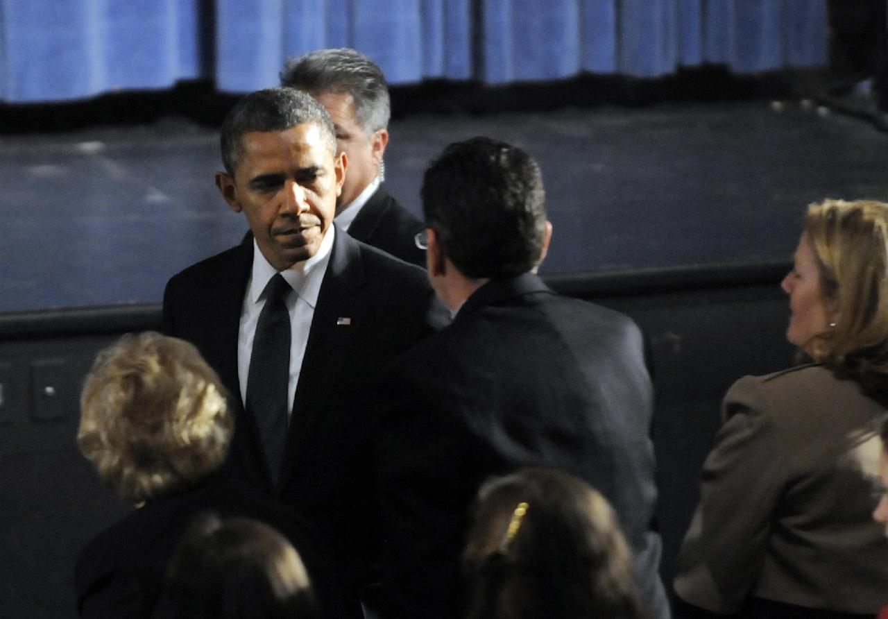 President Barack Obama greets Gov. Dannel Malloy during his arrival at the start of an interfaith vigil for the victims of the Sandy Hook Elementary School shooting on Sunday, Dec. 16, 2012 at Newtown High School in Newtown, Conn. A gunman walked into Sandy Hook Elementary School Friday and opened fire, killing 26 people, including 20 children. (AP Photo/The Hartford Courant, Stephen Dunn, Pool)