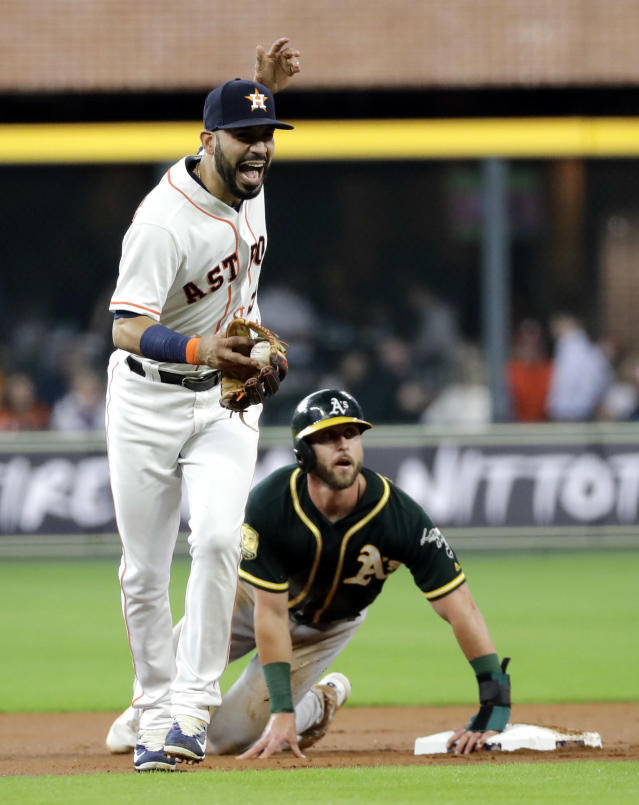Houston Astros shortstop Marwin Gonzalez, left, reacts after tagging out Oakland Athletics' Dustin Fowler at second base during the first inning of a baseball game Tuesday, July 10, 2018, in Houston. Gonzalez was injured on the play. (AP Photo/David J. Phillip)