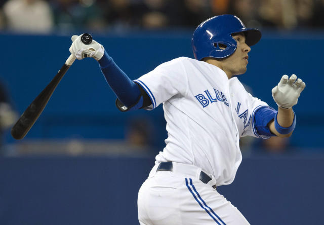 Toronto Blue Jays' Ryan Goins hits a home run against the New York Yankees during the fourth inning of MLB American League baseball action in Toronto Wednesday, Sept. 18, 2013. (AP Photo/The Canadian Press, Mark Blinch)