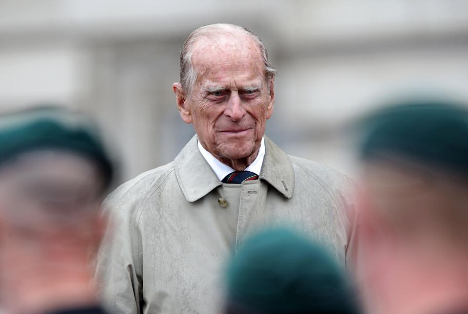 Britain's Prince Philip, Duke of Edinburgh, in his role as Captain General, Royal Marines, attends a Parade to mark the finale of the 1664 Global Challenge on the Buckingham Palace Forecourt in central London on August 2, 2017.   Prince Philip, the 96-year-old husband of Queen Elizabeth II, conducted his final solo public engagement on August 2, 2017, overseeing a military parade in the pouring rain before retiring from a lifetime of service. The Duke of Edinburgh, wearing a raincoat and bowler hat, met members of the Royal Marines and veterans -- many younger than him -- before taking the salute in the forecourt of Buckingham Palace.   / AFP PHOTO / POOL / Yui Mok        (Photo credit should read YUI MOK/AFP via Getty Images)
