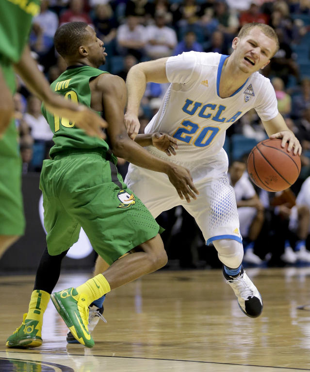 UCLA's Bryce Alford (20) drives against Oregon's Jonathan Loyd in the first half of an NCAA Pac-12 conference tournament quarterfinal college basketball game on Thursday, March 13, 2014, in Las Vegas. (AP Photo/Julie Jacobson)
