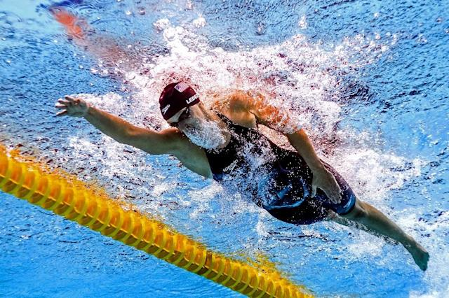 Five-time Olympic swimming champion Katie Ledecky has smashed her own 1,500m freestyle world record by five seconds (AFP Photo/François-Xavier MARIT)