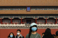 Tourists wearing face masks to help curb the spread of the coronavirus visit Forbidden City in Beijing, Sunday, Oct. 25, 2020. With the outbreak of COVID-19 largely under control within China's borders, the routines of normal daily life have begun to return for its citizens. (AP Photo/Andy Wong)