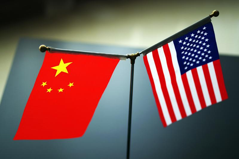 "--FILE--National flags of China and the United States are seen in Ji'nan city, east China's Shandong province, 31 May 2019. Even as Chinese and American trade negotiators laid plans to maintain ""intensive consultation"" this month, President Donald Trump said he will impose 10\% tariffs Sept. 1 on an additional $300 billion a year of imports from China. Trump disclosed the expansion of tariffs Thursday in a tweet in which he also complained that China failed to increase agricultural purchases and to cut off the flow of the opioid drug fentanyl to the U.S. from China as he said President Xi Jinping promised. Trump said the new duties will be in addition to the tariffs of as much as 25\% on $250 billion a year of Chinese imports. The Dow Jones Industrial Average plunged 200 points following the news, erasing a gain of 300 points earlier in the day. China didn't immediately respond to Trump's tweet, which he concluded by writing, ""We look forward to continuing our positive dialogue with China."" (Photo by Da qing - Imaginechina/Sipa USA)"