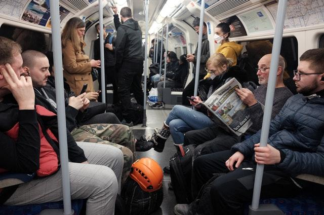 A busy Jubilee line eastbound train carriage, the day after Prime Minister Boris Johnson put the UK in lockdown