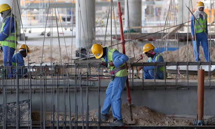Migrant labourers work on a construction site on October 3, 2013 in Doha (AFP Photo/Karim Jaafar)