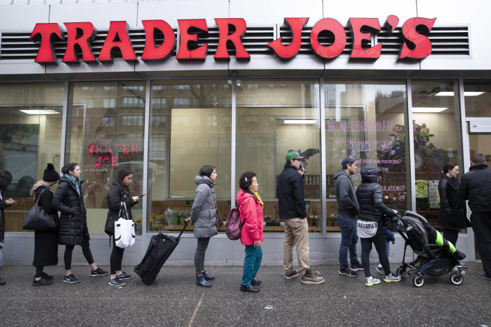 Customers line up to enter a Trader Joe's store in New York on March 13. (AP Photo/Mary Altaffer)