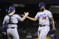 Los Angeles Dodgers catcher Will Smith and pitcher Kenley Jansen (74) celebrate after defeating the Arizona Diamondbacks 4-2 during a baseball game, Friday, Sept. 24, 2021, in Phoenix. (AP Photo/Rick Scuteri)