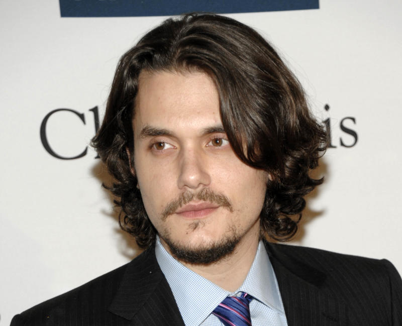 """FILE - This Feb. 12, 2011 file photo shows musician John Mayer at the Pre-Grammy Gala & Salute to Industry Icons with Clive Davis honoring David Geffen in Beverly Hills, Calif. Singer Taylor Swift has never revealed her target in the scathing song """"Dear John,"""" but John Mayer's pretty sure it was about him _ and he doesn't think that's cool. In a new Rolling Stone interview, Mayer called """"Dear John"""" cheap songwriting and said it made him feel terrible _ and he didn't deserve it. (AP Photo/Dan Steinberg, file)"""
