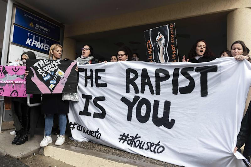 Activists outside court after a British woman was found guilty of faking a gang rape claim (AFP via Getty Images)