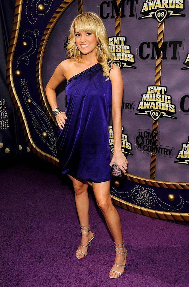 """Carrie Underwood arrived at the 2008 CMT Music Awards resembling one of """"Charlie's Angels"""" thanks to her feathered blond hair and sexy one-shoulder dress. Kevin Mazur/<a href=""""http://www.wireimage.com"""" target=""""new"""">WireImage.com</a> - April 14, 2008"""
