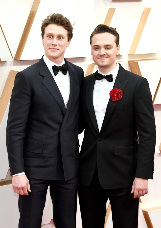 HOLLYWOOD, CALIFORNIA - FEBRUARY 09: (L-R) George MacKay and Dean-Charles Chapman attend the 92nd Annual Academy Awards at Hollywood and Highland on February 09, 2020 in Hollywood, California. (Photo by Kevin Mazur/Getty Images)